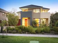 Foto de fachada de casa moderna pequeña con jardín en frente