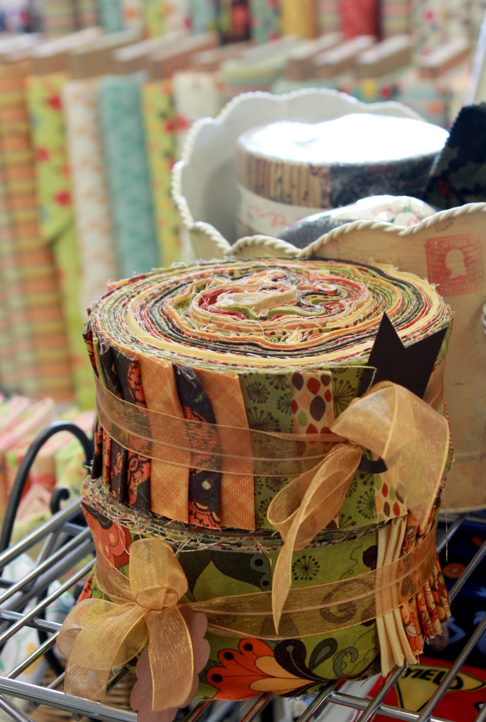 Pretty custom jelly roll bundles found at The Fabric Mill!