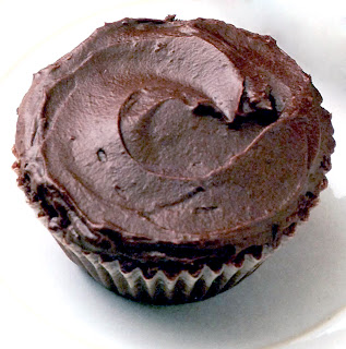 Classic chocolate cupcake with chocolate frosting in a swirl pattern