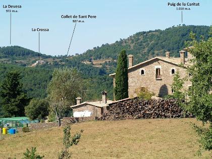 Vista de Postius i dels turons que envolten L'Estany