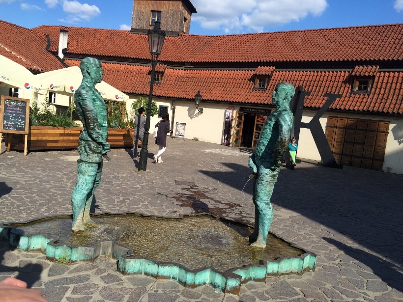 Prague peeing men