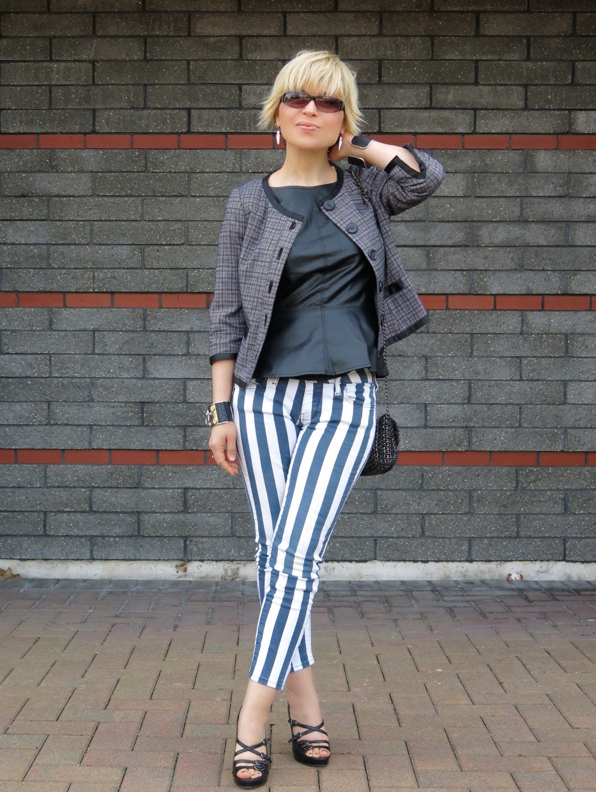 striped skinny jeans styled with a faux-leather peplum top and a Chanel-inspired jacket