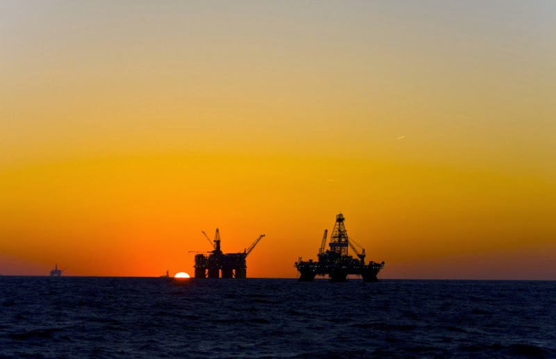 Oil platform silhouette in Gulf of Mexico (stock image). A new study finds that some 6 million to 10 million gallons are buried in the sediment on the Gulf floor, about 62 miles southeast of the Mississippi Delta. (Credit: © Lukasz Zakrzewski / Fotolia) Click to Enlarge.