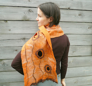 <p>Warm and soft, cozy and tender women wool scarf. Nice salmon - orange color, shining surface, circles of silk ribbon. This nuno felted scarf will be great gift for her.</p>