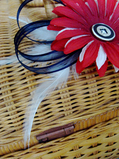 red, white, and blue 4th of July hair flower with feathers, ribbon, and vintage button center