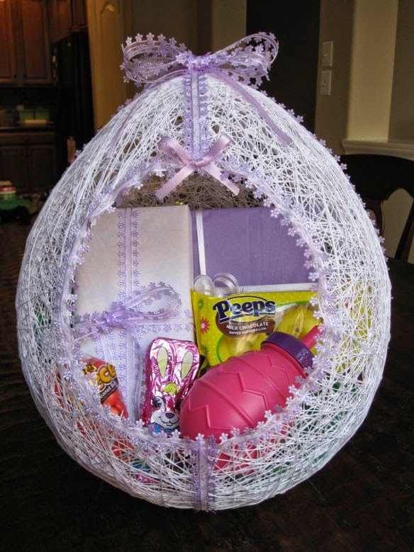 http://hmhdesigns.wordpress.com/2011/03/27/make-an-egg-shaped-easter-basket-from-string/