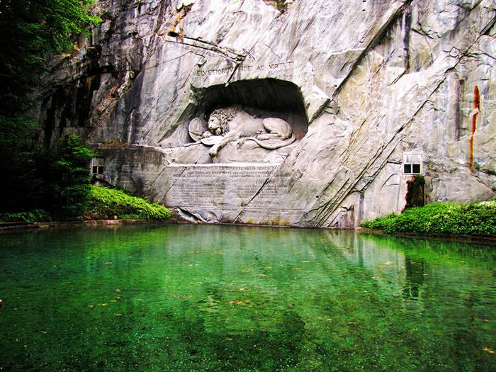 "The Lion Monument, or the Lion of Lucerne, is a sculpture in Lucerne, Switzerland, designed by Bertel Thorvaldsen and hewn in 1820–21 by Lukas Ahorn. It commemorates the Swiss Guards who were massacred in 1792 during the French Revolution, when revolutionaries stormed the Tuileries Palace in Paris, France. Mark Twain praised the sculpture of a mortally-wounded lion as ""the most mournful and moving piece of stone in the world."""