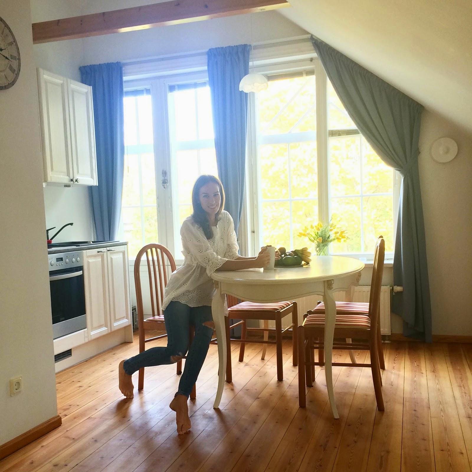 white-kitchen-wood-floor-large-windows