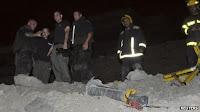 Israeli police inspecting the Grad rocket in Eilat