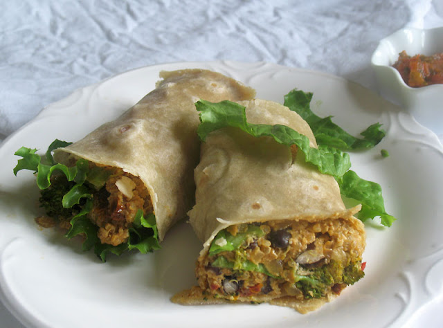 vegan quinoa black bean burrito with cashew cheese sauce