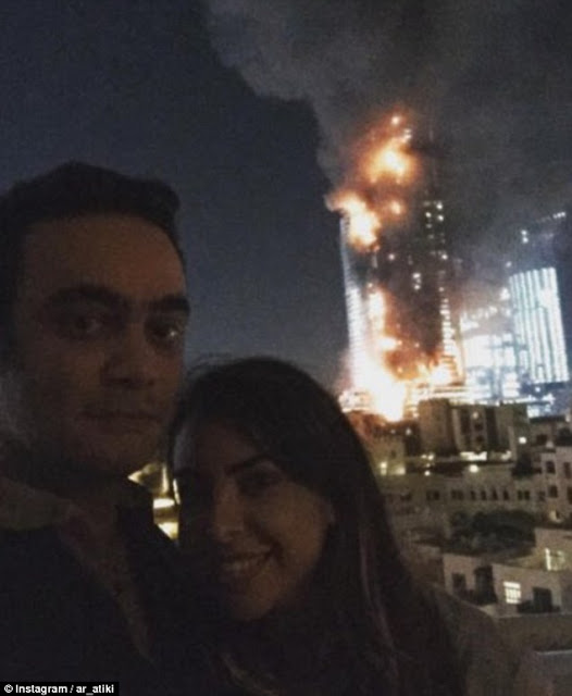 The popular luxury hotel, in the vicinity of Burj Khalifa, caught fire on the New Year eve and was covered by the who's who of the global media.   Sixteen persons were injured in the raging blaze that took hours to control.  But a man identifying himself as AR Alateeqi posted a grinning selfie with a woman, taken in front of the tower, which was still aflame.