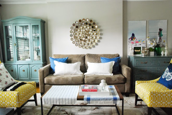 brown sofa living room ikea pillow blanket yellow blue