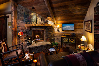 Rustic Fireplace Mantels from Stone in Living Room with Dark Sofa and Wooden Table under Wooden Ceiling
