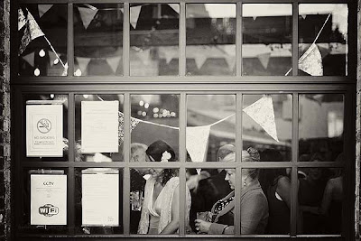 bride and guests through the window at St Chads place wedding
