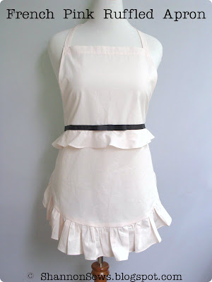 Handmade french style apron with pink ruffles and black bow accent