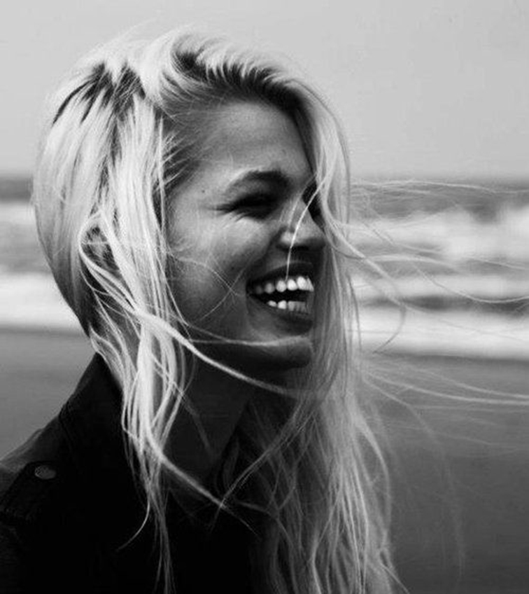 Daphne Groenveld, by the beach, laughing, babe