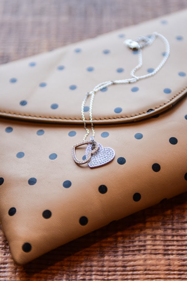 Swarovski Amorous pendant styled with J. Crew polka dot invitation clutch