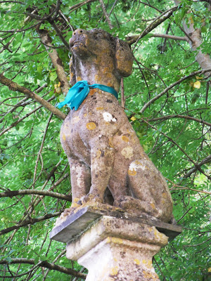 Dog statue in Tawstock Devon with ribbons