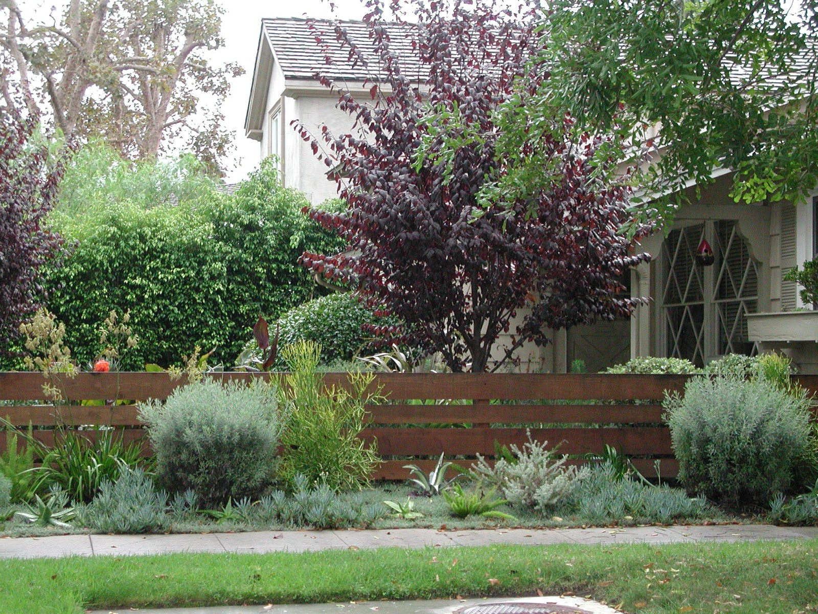 Horizontal Wood Fence Front Yard This simple fence with