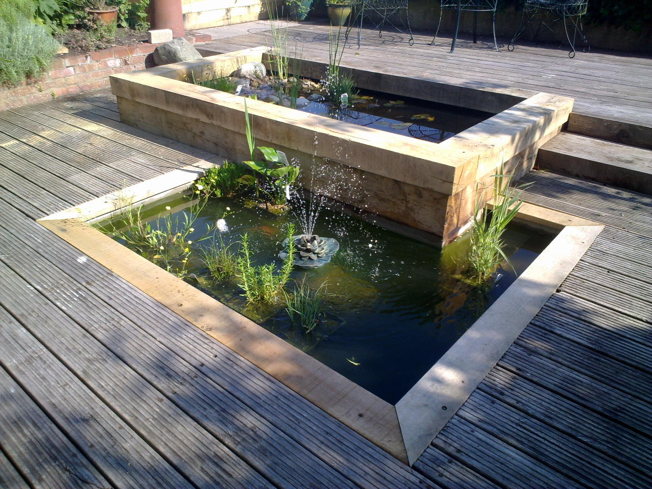Our projects past and present slideshow for Garden decking with pond