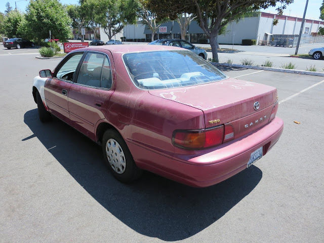 1995 Camry with delaminating clear coat and collision damage before repairs at Almost Everything Auto Body