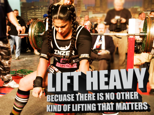 Lady lifting heavy weights | The Fittest Blogger