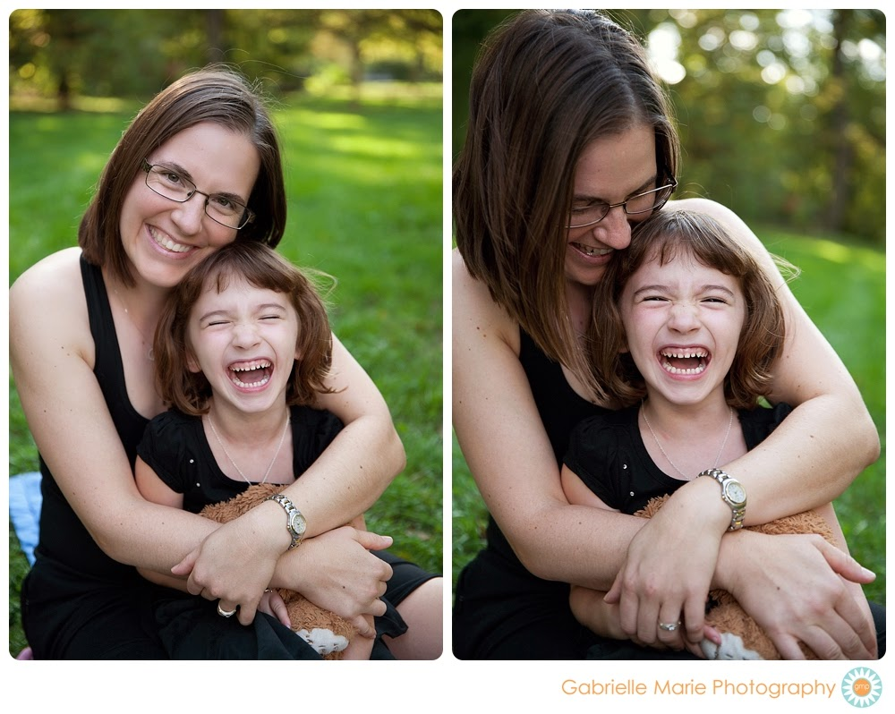 Happy mother and young daughter cuddling in a park laughing - Best of 2013 Family Portraits in St. Louis