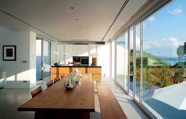 The linear kitchen/dining area