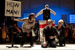 Music Theatre Wales: Greek; l-r: Sally Silver (Mum), Marcus Farnsworth  (Eddy), Louise Winter (Wife). Photo: Clive Barda.