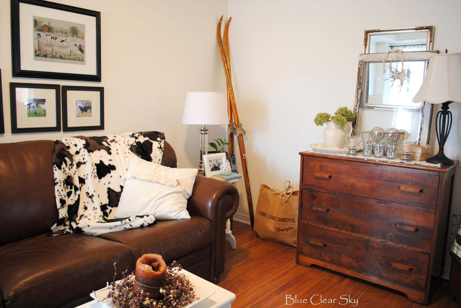 cowboy living room. The vintage skis also stayed  along with the burlap Wrangler LONG LIVE COWBOYS bag filled my knitting and crochet projects so they are close at hand Rustic Maple Our Living Room for Winter