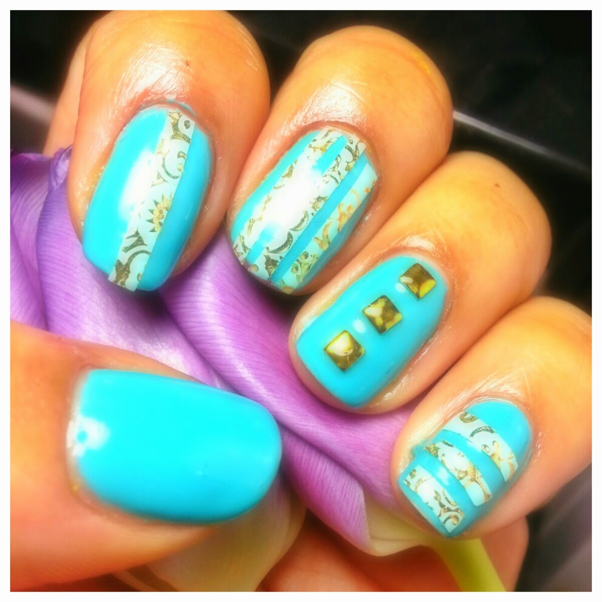 A picture of nails with Sally Hansen Gel Polish in #370 For Teal with Revlon by Marchesa 24k Brocade