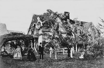 Three generations of the Aspinwall family pose before the family home and the remains of the celebrated Aspinwall Elm after it came down in a gale in September 1863