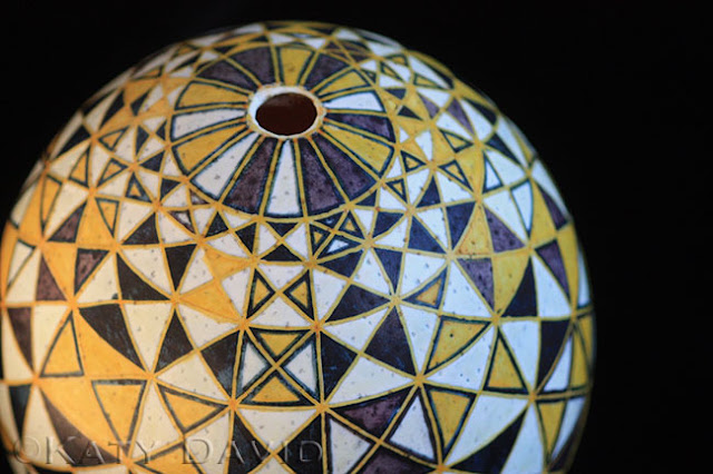 "©Katy David, ""Blackbird Mapped in Yellow"" 2015, Ostrich egg, aniline dye"