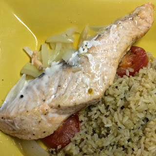 Salmon with tomatoes and onions served