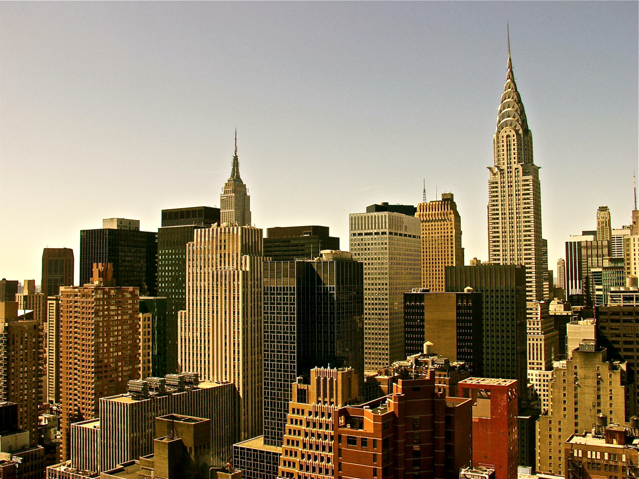 http://2.bp.blogspot.com/-80aVsfb31eI/T8D31ox3m5I/AAAAAAAABWc/nNaPii_1zoA/s1600/New+York+Skyline+%28Midtown%29,+photograph,+2006.jpg