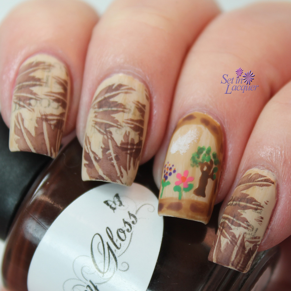 Finist the Falcon nail art with stamped feathers