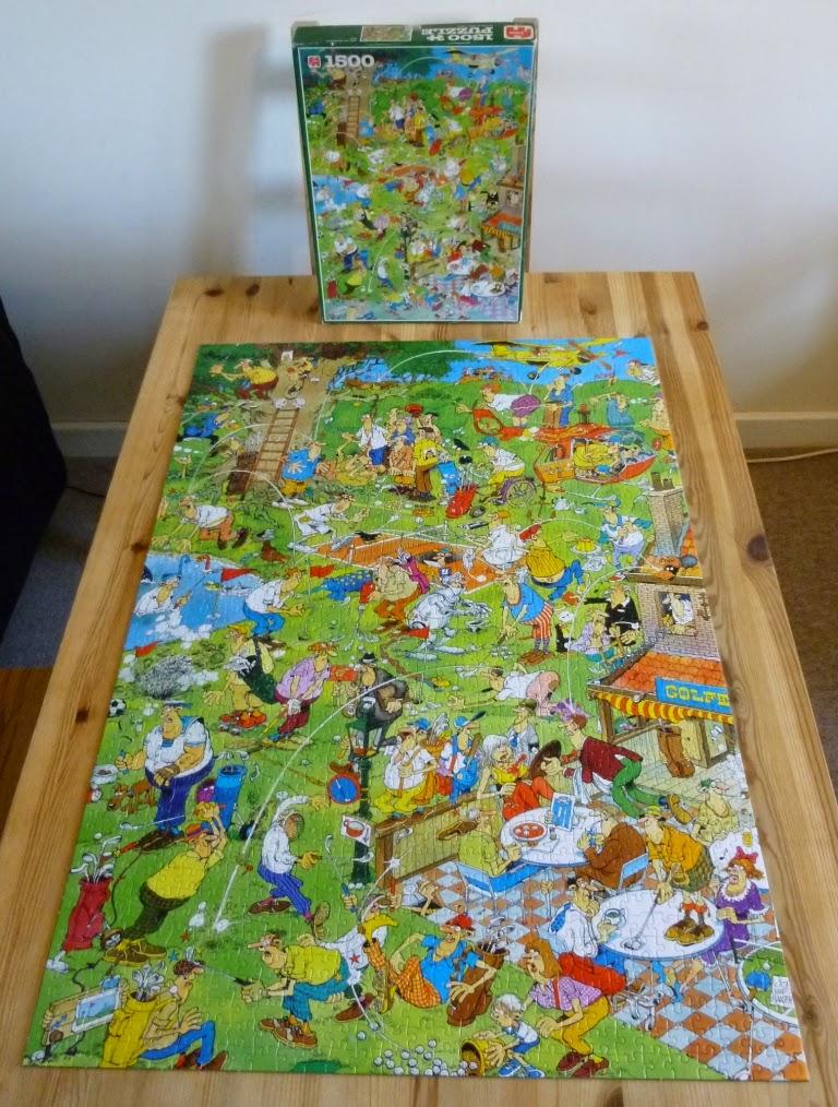 The completed Jan Van Haasteren Golf jigsaw puzzle