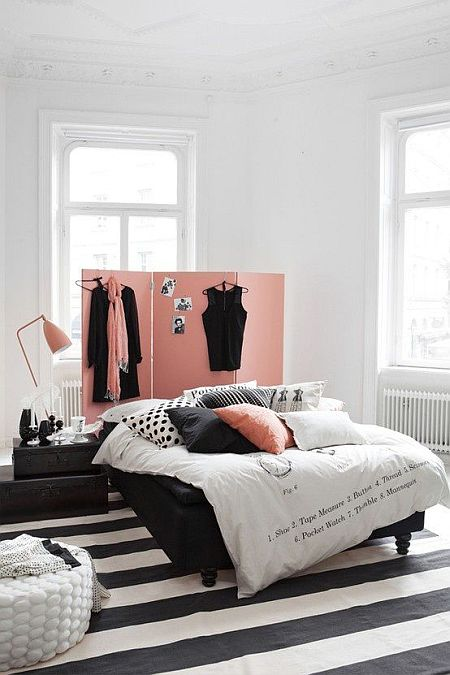 so chic and feminine bedroom with black and white rug