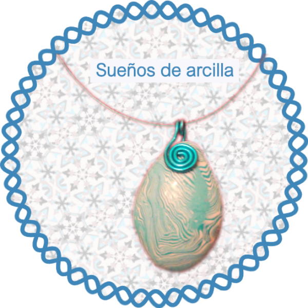 colgante de arcilla polimérica a vetas blancas y azules