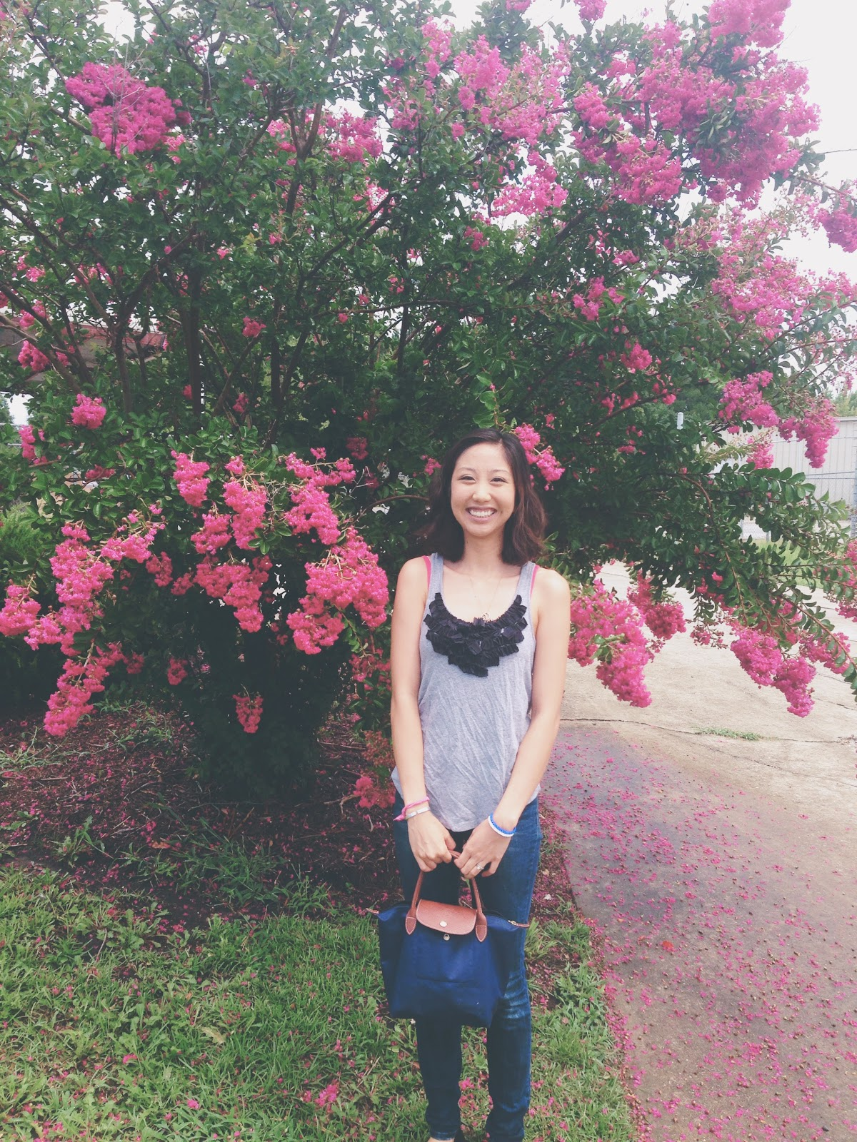 me in front of pink flowers