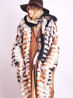 Vintage 1970's brown and ivory colored fox fur, suede and wool maxi coat with hood.