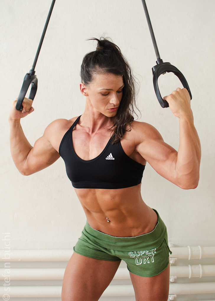 Cindy Landolt Flexes Her Biceps And Fit Abs