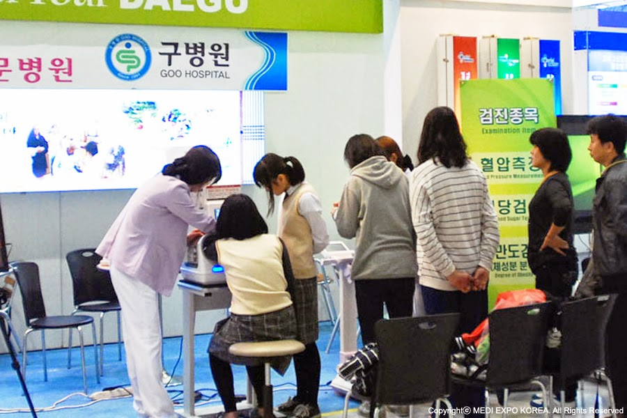 Visitors is offered a free medical examination service at the booth in Medi Expo exhibition hall.