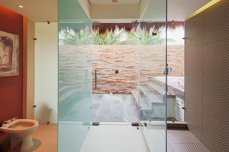Bathroom with glass doors in Modern villa on the beach in Mexico