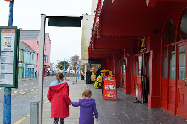 Sisters hold hand in seaside town