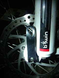 Image showing a Quick release locked correctly, with the word CLOSE visible. Front disc hub of BTwin Rockrider 5.3 used for demonstration.