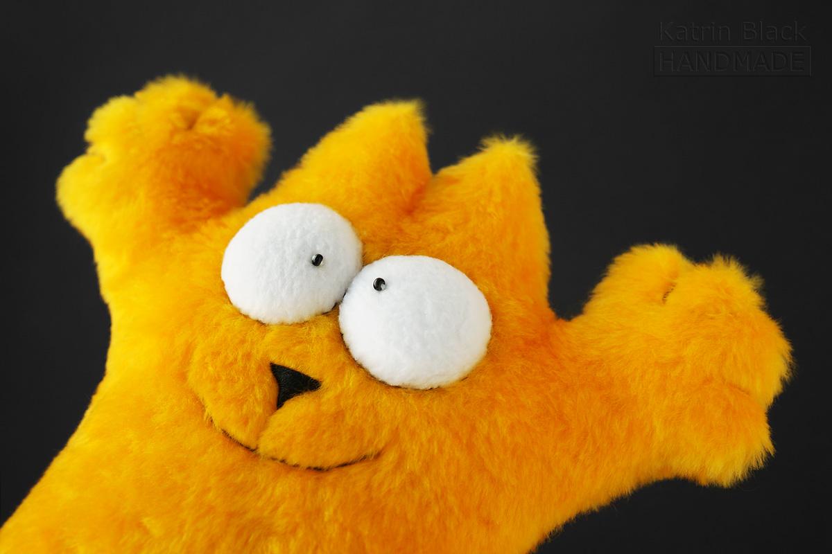 Кот Саймона из жизнерадостного жёлтого меха.