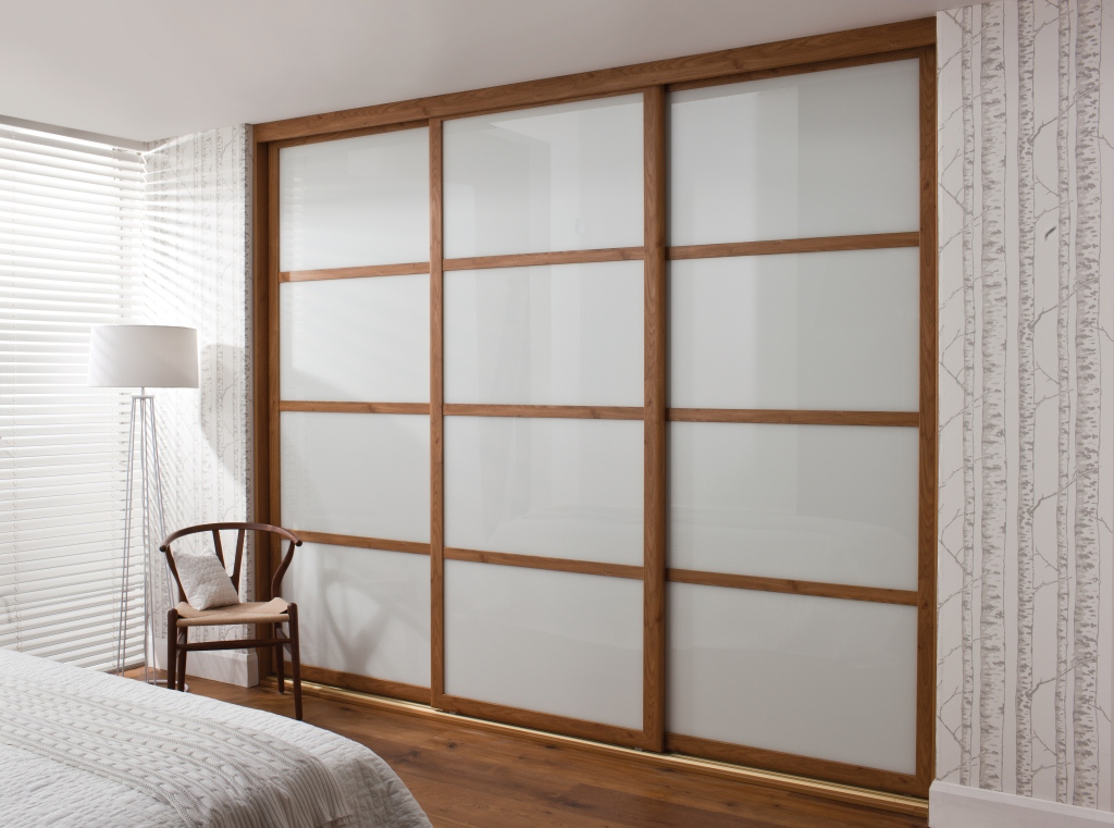 Beautiful elegant wooden wardrobe simple home decoration for Wooden sliding doors