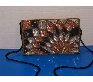 https://www.goodsmiths.com/purse-onality/colorful-sequin-flower-diamond-leaf-pedals-black-beaded-sequin