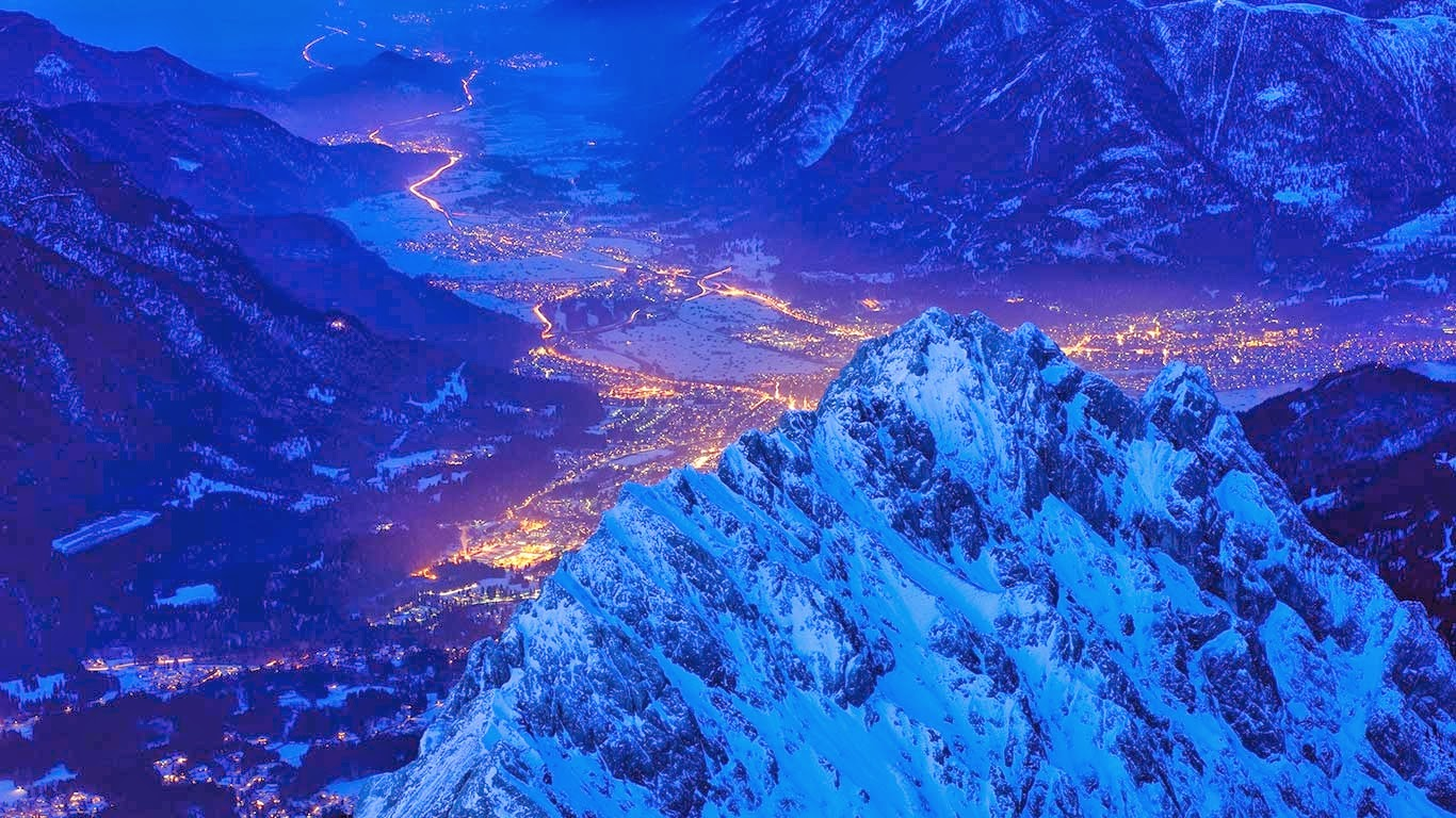 View over Waxenstein crest on illuminated town of Garmisch, Bavaria, Germany (© Olaf Broders Nature Photography/Getty Images) 272